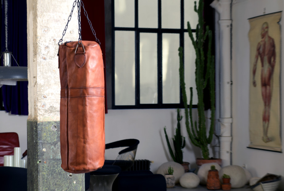leather punching bag cognac in a loft