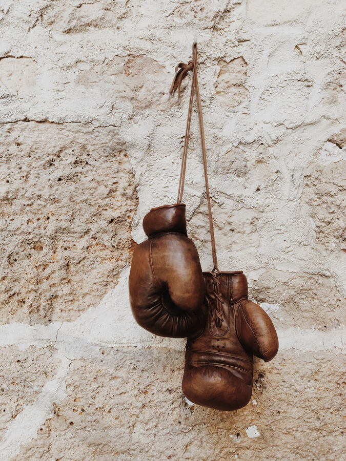 old school leather boxing gloves hooked