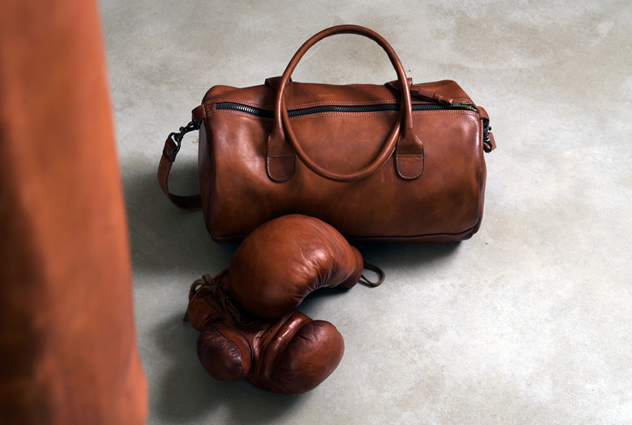 leather sports bag, old school boxing gloves